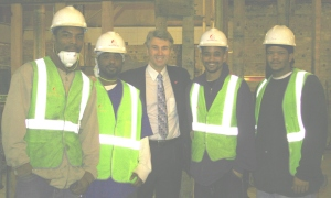Standing with construction workers at new % Points development